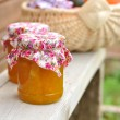Two Jars of Pumpkin Jam on a Bench, copy space for your text — Stock Photo