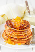 A Stack of Pumpkin Pancakes Topped with Pumpkin-in-Syrup Preserves, copy space for your text — Fotografia Stock
