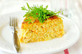 A Slice of Zucchini and Carrot Bake with Rocket, shallow depth of field — Stock Photo
