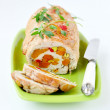 Baked turkey roll stuffed with dried apricots, cherries and pist — Stock Photo