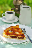 A piece of Italian date and mascarpone tart — Stock Photo