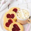 Homemade Cookies with Heart-Shaped Center and a Cup of Hot Choco — Stock Photo #38096049