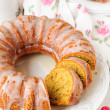 Stock Photo: Sliced Pumpkin Bundt Cake with Sugar Icing