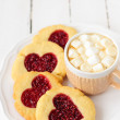 Homemade Cookies with Heart-Shaped Center and a Cup of Hot Choco — Stock Photo #39597851