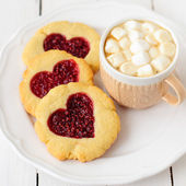 Homemade Cookies with Heart-Shaped Center and a Cup of Hot Choco — Stock Photo