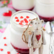 Teddy Bear Toy Leaning over a Jar of Yoghurt with Raspberry Jam — Stock Photo