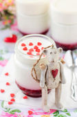 Teddy Bear Toy Leaning over a Jar of Yoghurt with Raspberry Jam — Stockfoto