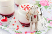 A Jar of Yoghurt with Raspberry Jam and a Teddy Bear Toy Leaning — Stock Photo