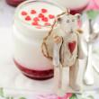 Teddy Bear Toy Leaning over a Jar of Yoghurt with Raspberry Jam — Stock Photo