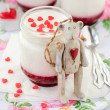 A Jar of Yoghurt with Raspberry Jam and a Teddy Bear Toy Leaning — Stock Photo #40837137