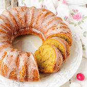 Sliced Pumpkin Bundt Cake with Sugar Icing — Stock Photo