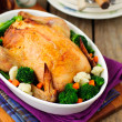Whole Roast Chicken Stuffed with Bread and Cheese Served with St — Stock Photo #42058601