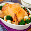 Whole Roast Chicken Stuffed with Bread and Cheese Served with St — Stock Photo #42058603