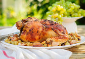 Whole Roast Chicken with Grapes, Garlic and Almonds — Stock Photo