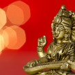 Close up of hindu deity statue on red background — Stock Photo #24952239