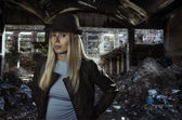 Young blonde in ruins — Stock Photo