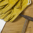 Plans and tools on a wooden floor — Stock Photo