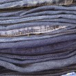Stock Photo: Close up stack of folded jeans vertical