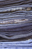 Close up stack of folded jeans vertical — Stock Photo