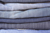 Close up stack of folded jeans horizontal — Stock Photo