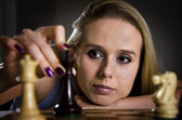 Woman making her move in chess — Stock Photo