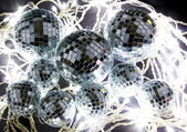 Christmas mirrow balls and light — Stock Photo