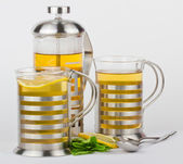 Teapot and cups with mint and lemon — Stock Photo