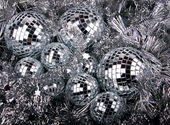 Mirrow christmas balls on silver — Stock Photo