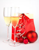 Champagne glasses with christmas present on white — Stockfoto