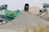 Conveyors with stones and sand — Stock Photo