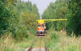 Special train crane carriage in forest with workers — Stock Photo