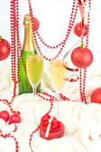 Red Christmas composition with champagne and present — Stock Photo
