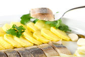 Portion of herring fish fillets with potato and onion — Stock Photo