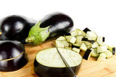 Eggplant with slices and cuts background — Stock Photo