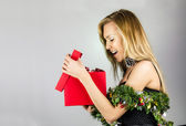 Pretty yound blond woman with Christmas present — Stock Photo