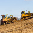 Two bulldozer at Work in forest - Stock Photo