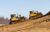 Two bulldozer at Work in forest — Stock Photo