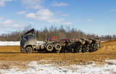 Truck with sand overturned accident — Stock Photo