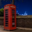 Red telephone and Tower Bridge at night, London, England — Stock Photo