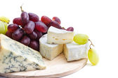 Cheese plate with grape — Stock Photo
