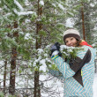 Woman outdoors at winter forest — Stock Photo