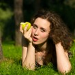 Young pretty woman eating apple — Stock Photo