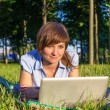 Stock Photo: Young woman with laptop outdoors