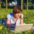 Young woman with laptop outdoors — Stock Photo #31807667