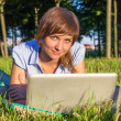Young woman with laptop outdoors — Stock Photo #31807673