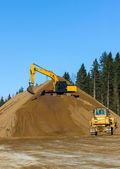 Yellow Excavator and bulldozer at Work in forest — Stock Photo