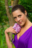 Young pretty woman with flower — Stock Photo