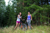 Two Young pretty woman and bicycle — Foto Stock