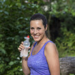 Young pretty woman drinks water — Stock Photo