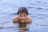 Little boy swimming in a lake — Stock Photo
